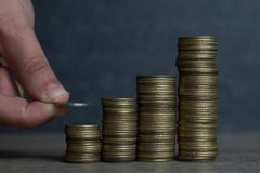 Hand put Coins to stack of coins,Concept Saving money Royalty Free Stock Photo