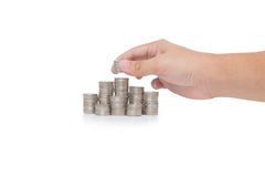 Hand put coins to stack of coins isolated on white Royalty Free Stock Photo