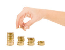Hand put coins to stack of coins. On white background Stock Images