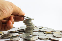 Hand put coins to stack of coins Royalty Free Stock Photos