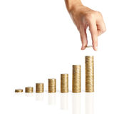 Hand put coins to stack of coins Royalty Free Stock Images