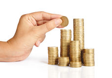 Hand put coins to stack of coins Royalty Free Stock Photography