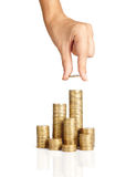 Hand put coins to stack of coins Royalty Free Stock Photo