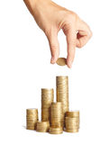 Hand put coins to stack of coins Royalty Free Stock Image
