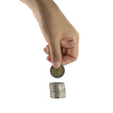 Hand put coins to stack isolated on white. Stock Image