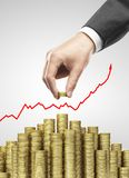 Hand put gold coins. Hand put coins to money staircase Stock Image