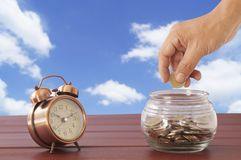 Hand put money coin deposit of save Stock Photo