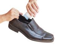 Hand put powder to a shoe, odor stop Stock Photo