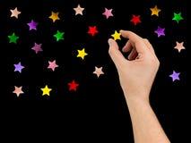 Hand put star to night sky Royalty Free Stock Photos