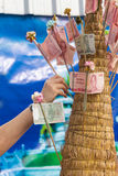 Hand put thai banknote in make merit Stock Photography