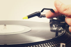 Hand put the tonearm on vinyl record Royalty Free Stock Photography