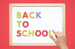 Hand put the words Back To School on magnetic board Stock Photography