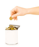 Hand puts a coin in the tin Stock Images