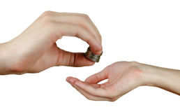 Hand puts coins in the other hand. Hands holding money. Transfer Royalty Free Stock Photography