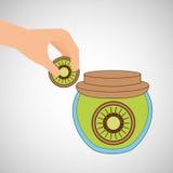 Hand puts kiwi jar jam Royalty Free Stock Image