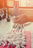 A hand puts pieces of marinated chicken on a spit in the kitchen on a Sunny day. Royalty Free Stock Photos