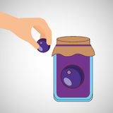 Hand puts plum jar jam Stock Photography