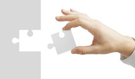 Hand puts puzzle Royalty Free Stock Photo