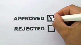Hand puts a sign in approved check box stock video footage