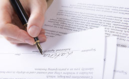 Hand puts the signature in the contract Royalty Free Stock Image