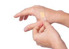Hand putting Adhesive Bandage Stock Images
