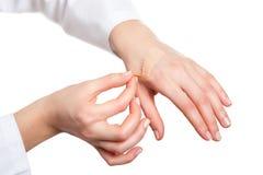 Hand putting adhesive bandage Stock Image