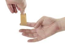Hand putting Adhesive Bandage. Isolated on white. Royalty Free Stock Photography