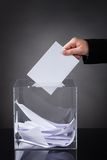 Hand putting ballot in box Royalty Free Stock Image