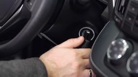 Hand putting car key to the keyhole, starting the car stock video footage