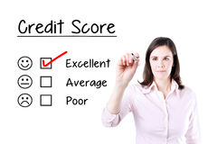 Hand putting check mark with red marker on excellent credit score evaluation form. Stock Photos