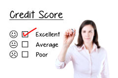Hand putting check mark with red marker on excellent credit score evaluation form. Isolated on white. Royalty Free Stock Photos