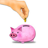 Hand putting coil to piggy bank. Royalty Free Stock Images
