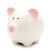 Hand putting a coin into piggy bank Stock Images