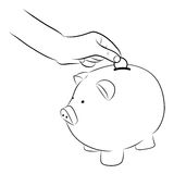 Hand putting coins into saving piggy bank Royalty Free Stock Image