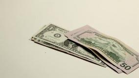 Hand putting dollar bills stock video footage