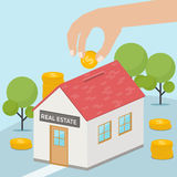 Hand putting dollar coin into a house bank. Saving money for real estate investing. Investment concept. Royalty Free Stock Image