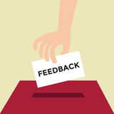 Hand putting Feedback paper in the box Royalty Free Stock Image