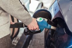 Hand putting gasoline stock images