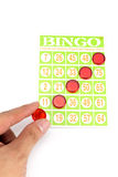 Hand putting last chip to be winner of bingo game Royalty Free Stock Image
