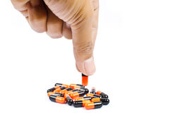 Hand putting medicine isolated. Royalty Free Stock Photos