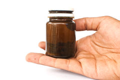 Hand putting medicine isolated on the white. Stock Images