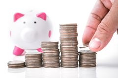 Hand putting money coin stack Stock Photography