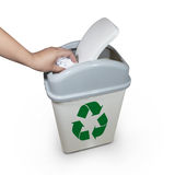Hand putting a paper garbage into bin Royalty Free Stock Photo