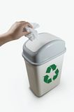 Hand putting a paper garbage into recycling bin Royalty Free Stock Image