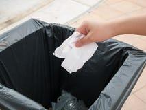 Putting paper into trash bin Royalty Free Stock Photo
