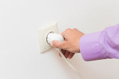 Hand Putting Plug Into Electricity Socket Stock Photo