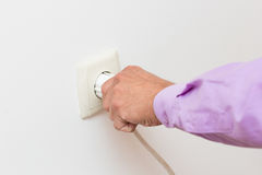Hand Putting Plug Into Electricity Socket Stock Image