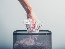 Hand putting shredded paper in basket Stock Photography