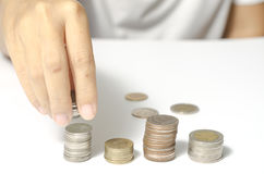 Hand putting stack of coins Royalty Free Stock Photo