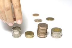 Hand putting stack of coins Stock Image